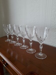 A lovely set of six pretty H19cm crystal cut wine glasses