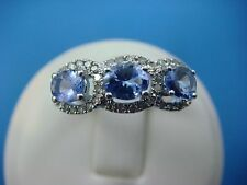 1.0 CT T.W. GENUINE TANZANITE ACCENTED BY 0.25 CT T.W. DIAMONDS LADIES GOLD RING