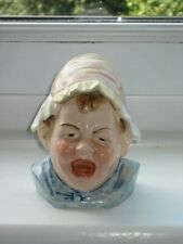 'CRYING BABY WEARING BONNET' TOBACCO JAR - LATE 19TH CENTURY