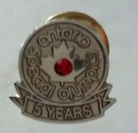 Special Olinpics Ontario Pin Whit A stone on The Center.