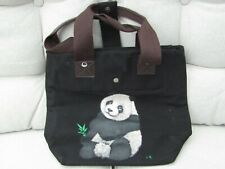 Panda Tote Bag. Black Canvas. With brown handles. Used but good condition.