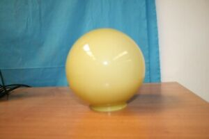 "Pale yellow six"" glass globe shade with white glass inside"