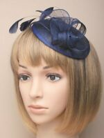 Navy blue fascinator with hessian petals and feather tendrils. Set on alice h...