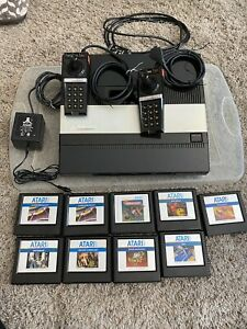 atari 5200 console with 9 games, 2 controllers, power supply, untested.