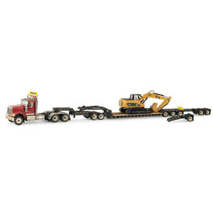 1/50 International HX520 Truck and XL 120 Trailer with Dusty Cat Excavator 85613