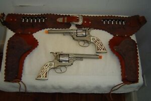 HUBLEY COLT 38 DOUBLE HOLSTER AND CAP GUNS.
