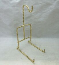 Twisted brass cup & saucer display, holder
