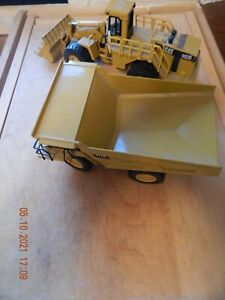 Norscot: Caterpillar 992G Articulated Front Loader AND 777D DUMP TRUCK USED