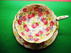 BEAUTIFUL  FOOTED CUP AND SAUCER COVERED IN LITTLE CABBAGE ROSES