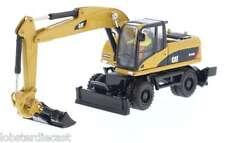 Diecast Masters CAT M318D Escavatore RUOTE SCALA 1/87, modello 85177
