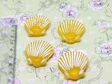 8 little yellow resin scallop shells
