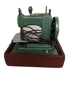 Vintage Betsy Ross toy electric sewing machine model 707-E, green with red case