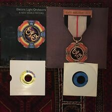 "Electric Light Orchestra : LP & 2 7"" 45s - Greatest Hits/New World Record + 2"