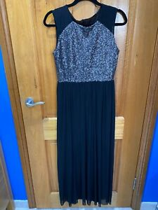 Long black sequinced and chiffon dress. Stretchy material. Size UK 12.