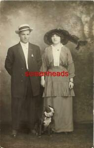 C1910 RPPC PHOTO BOSTON TERRIER DOG WITH OWNERS VG Vintage Clothes