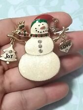 Sparkling fun snowman pin brooch with Love, star and joy pendants.