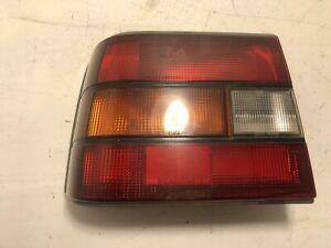 85-86 CHEVROLET SPECTRUM LEFT SIDE TAIL LIGHT LAMP LID MOUNTED OEM,166-58105B