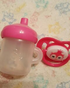 ONE MAGNETIC HOME MADE  PACIFIER, AND ONE BABY ALIVE SIPPY CUP NO DOLL INCLUDED