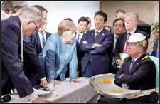 "MERKEL STANDING OVER TRUMP IN HIGHCHAIR AT G7 HUMOUROUS FRIDGE MAGNET 5"" X 3.5"""