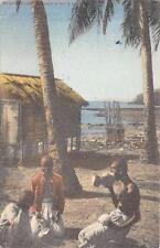 CPA MADAGASCAR COMMENT SE BOIT LE LAIT DE COCO (cpa avec timbre d'origine