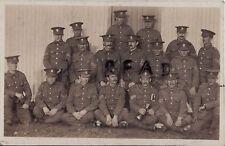 WW1 Soldier group Welsh Regiment NCO's standing beside corrugated barrack hut