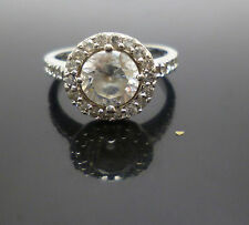 Sterling silver synthetic diamond solitaire halo ring with accented shoulders