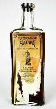 EARLY!  KICKAPOO SAGWA EMBOSSED MEDICINE BOTTLE WITH LABEL, INDIAN CHIEF PICTURE