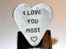 Heart shaped aluminum guitar pick stamped with love you the most