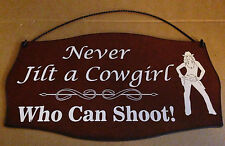 Metal Sign Never Jilt a Cowgirl - Who Can Shoot