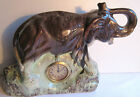 Sculpture Art Déco avec pendulette: Eléphant à la trompe levée, en céramique