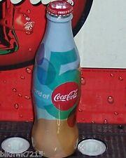 2012 WORLD OF COCA COLA ATLANTA 5 YEARS WRAPPED 8OZ COCA - COLA GLASS BOTTLE