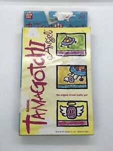New Tamagotchi Original English Angel Pearl Yellow Gold 1997 Bandai Virtual Pet