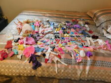 MIXED LOT OF BARBIES, CLOTHES AND OTHER MISC ACCESSORIES