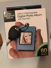 The Sharper Image 1.4'' Digital Photo Album with Keychain USB 2.0 Rechargeable
