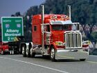 "1/64 DCP RED PETERBILT 389 TRI-AXLE W/ 70"" SLEEPER"