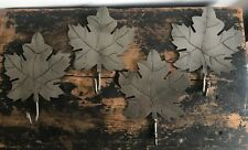 Four handmade metal leaf shaped coat hooks