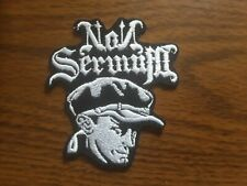 NON SERVIUM,IRON ON WHITE EMBROIDERED PATCH