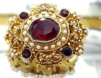 Vintage Ruby stone glass gold tone brooch.