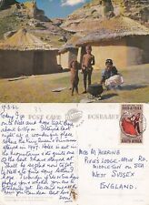 1960's FIRE STOKING IN A BASUTO KRAAL SOUTH AFRICA COLOUR POSTCARD