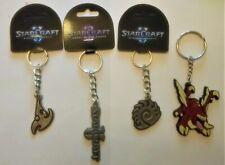 Blizzard StarCraft II lot of 4 Protoss Zergling Zerg Logo Key Chain zipper pulls