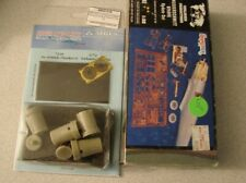 assortment of scale modeling tools and resin parts for 1/32 bf-109