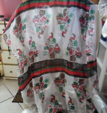 Red, green and white Christmas scarf with Santa, trees, presents and more