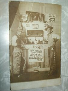 RPPC Real Photo Cowboy Postcard.Chaps.Slippery Bill Wanted.Saloon.Bar.Pistols.NR