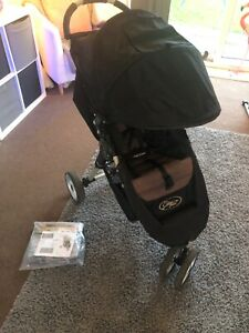 Black baby jogger city mini with raincover