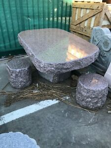 Unique and Unusual 5-Piece Granite Table and Stools