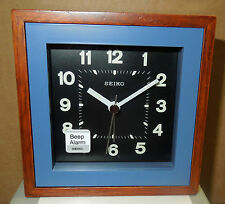 SEIKO -  SQUARE  WOOD TRIM WITH BLUE SURROUND BEEP ALARM CLOCK QXE047LLH