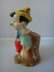 Walt Disney Ent Crown Toy 1940s - Pinocchio on Tree Stump Composition Coin Bank
