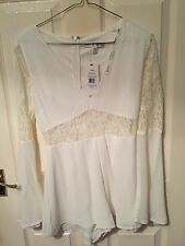 d21412f32a White Rare London playsuit size 8