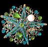 Große Brosche bzw. Anhänger, grün und blau kristallbesetzter Seestern mit Perle