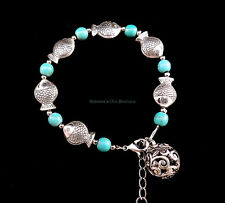 Turquoise bead bracelet w/ Tibetan silver fish and filigree of sphere